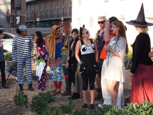 Various garden volunteers compete in a costume contest.