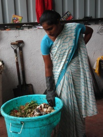 Worker delivers organic waste to biogas plant