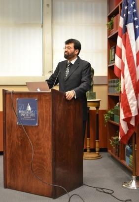 Dr. Tariq Banuri introduces guest speaker John de Graaf at the Hinckley Institute of Politics on the University of Utah campus on Nov. 14, 2013.