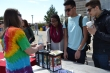 Environmental Humanities Graduate Assistant Laura Schmidt teaches students about the intricacies of recycling during Earth Fest.