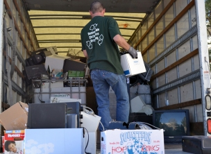 Metech Recycling loads electronics on the truck at the U's annual e-waste collection.