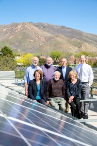University of Utah administrators pose with solar panels on the Turpin University Services Building to promote U Community Solar. Back row, from left: Frank Brown, dean of the College of Mines and Earth Sciences; Jim Ehleringer, director of the Global Change & Sustainability Center (GCSC); Robert Adler, interim dean of the College of Law; and Steve Burian, assistant director of the GCSC. Front row, from left: Ruth Watkins, sr. vice president of Academic Affairs; David Chapman, former dean of the Graduate School; and Brenda Bowen, assistant director of the GCSC.