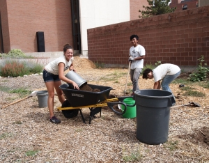 Real Food Rising volunteers work to save improved soil at the Pioneer Garden site.