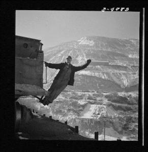 Andreas Feininger (American, 1906-1999), Utah Copper: Bingham Mine. Brakeman of an ore train at the open-pit mining operations of Utah Copper Company, at Bingham Canyon, Utah. Photo Credit: Digital reproduction from vintage negative, courtesy of the Library of Congress Prints and Photographs Division.
