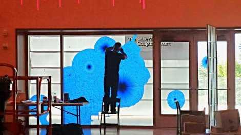 Tony Feher installs a new exhibition at UMFA. Photo courtesy UMFA.