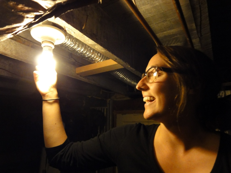 CFL bulbs -- a bright idea! Student Energy Ambassador Carlie Teague installs an energy efficient light bulb during a recent home energy audit.