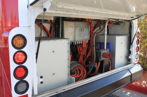 """A look under the """"hood"""" of the electric bus. Not all cords were cut at the event."""