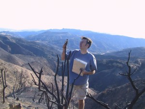 U of U Geography Professor Philip Dennison measuring burned vegetation in  Southern California after a 2003 wildfire. Photo by Philip Dennison.