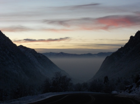 An inverted sunset- the mid-January sun sets over a smoggy layer of pollution . View from Little Cottonwood Canyon. Photo: Laura Schmidt