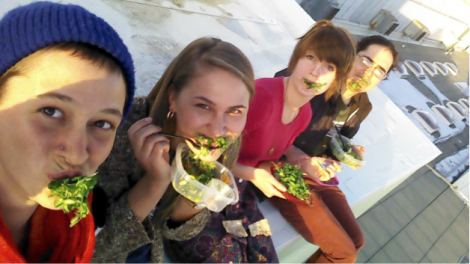 Erika Longino, Molly Mostert, Emma Wilson and Eric Devey enjoying fresh salads at sunset.