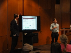 ASUU Student Body President Justin Spangler and U of U grad Tom Melburn present the recently-unveiled Marriott Library solar dashboard to Monday's audience.