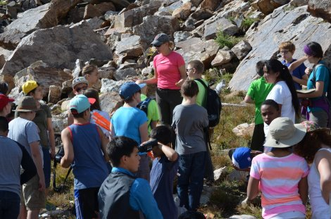 Varner working with middle school students, high up in mountainous pika habitat. Photo: Johanna Varner.