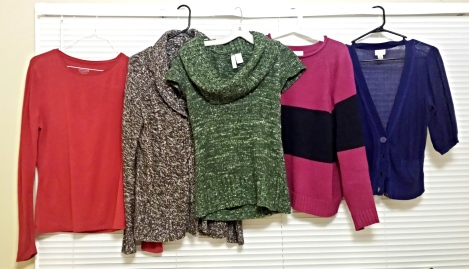 Collection of the author's second-hand-purchased shirts and sweaters.
