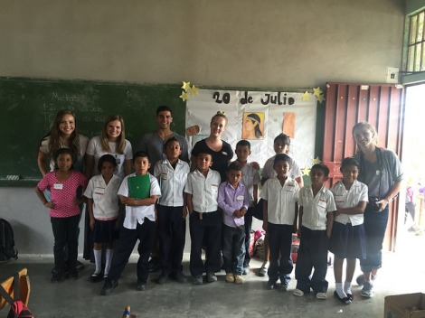 Global Brigade volunteers visiting local school children.