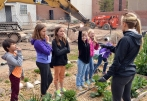 Elementary students answer questions about gardening at one of the Edible Campus Gardens sites.