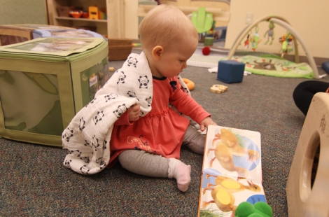 An infant plays with safer products at the U's new infant daycare room.