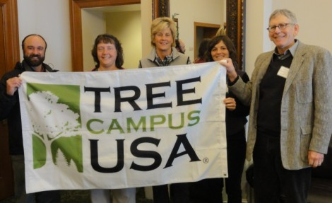 Members of the University of Utah's Campus Tree Committee hold the Tree Campus USA flag they received at a luncheon Wednesday. Left to right are U Parks, Recreation and Tourism graduate student Troy Bennett; Red Butte Gardens horticulture director Marita Tewes Tyrolt; U of U Facilitites Management, grounds and open spaces supervisor Sue Pope; U of U Parks, Recreation, and Tourism PhD candidate Elise Gatti, and Sustainability Resource Center director Myron Willson.