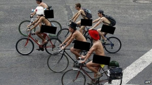 Yesterday's shirt... because you probably wouldn't make it to work or school this way. Original image of World Naked Bike Ride Day from Agence France Presse.