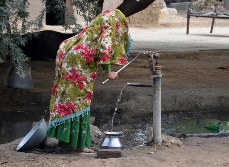 A woman pumps water in a village in Pakistan. Photo by Digni Norge/Flickr