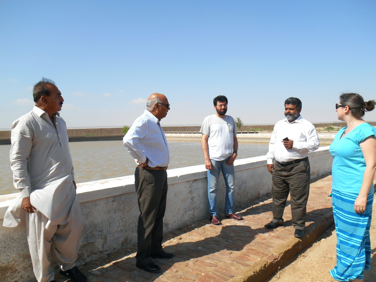 Mehran University of Engineering and Technology Professor Rasool Bux Mahar (second from right) explains the water treatment process for the campus to University of Utah faculty members Christine Pomeroy, Tariq Banuri, and Aslam Chaudhry.