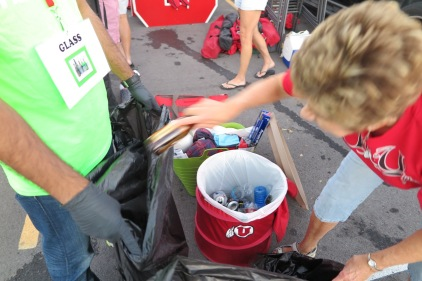 Ute fan sorting glass, plastic, and aluminum recyclables.