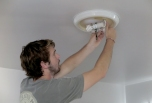 Energy Ambassador Jack Egan installs two CFL bulbs, which are more efficient and last longer than the old incandescent bulbs. For the first time, the Energy Ambassador team is also giving out one LED bulb, which is the most efficient bulb on the market.