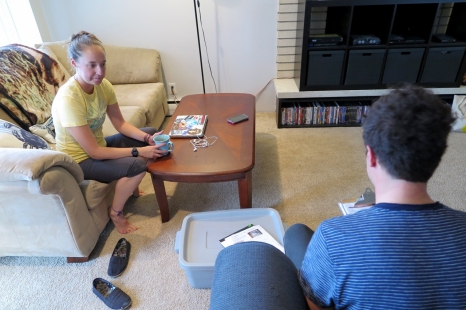 Energy Ambassador Nate Bramhall asks U student Carlie Teague about her energy and water use habits. The Energy Ambassador team starts out every audit getting to know the resident and their current behaviors.