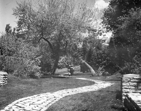 "Cottam's Gulch, as seen in the 1950's. The senior class of 1947 named this picturesque pathway near President's Circle in honor of ""Doc"" Cottam. Photo courtesy of University Archives."