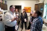 Jim Manzanares, a professional auditor with Questar, talks to Sustainability Office staffer Emerson Andrews about energy use in his kitchen. The Energy Ambassador team shadowed Jim at the house to learn more about energy and water conservation.