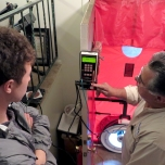Jim shows Nate the settings on a blower door test. Questar can perform blower door tests as part of their Thermwise audit program. Jim used the test to show the team the most likely areas of a home for heating and cooling loss.