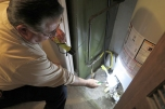 Jim shows the Energy Ambassador team how to check the water temperature in a home. Most water heaters have an ideal setting marked on the dial right around 120 degrees Fahrenheit.