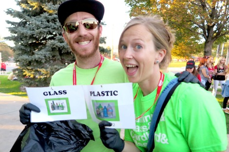 Volunteers having fun and showing off their recycle signs