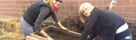 Nicole and Natalie sifting compost last fall at the Pioneer Gardens Soiree.
