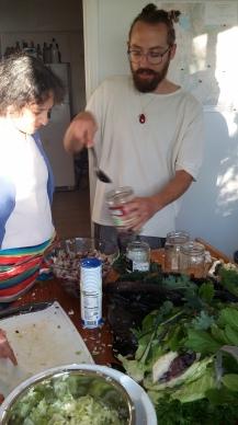Bradley Deherrera packs his sauerkraut ferment, we bet he'll share his recipe!