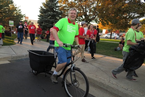 Christensen on the Recycbike collecting recyclables during a home football game.