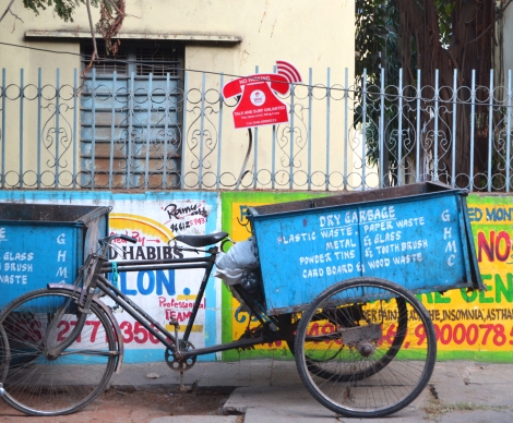 In many neighborhoods, this bike represents one of the methods of trash collection.