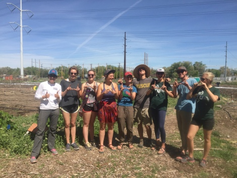 "The Edible Campus Gardens and New Roots crew flashing the ""U"""