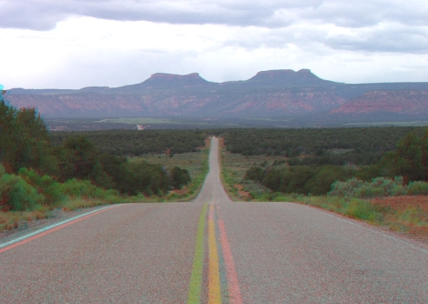 Photo of Bears Ears, visible beyond a highway.
