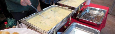 Student serves soup.