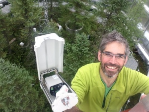 Richardson installing a camera at the SPRUCE experiment in northern Minnesota. Courtesy of Andrew Richardson.
